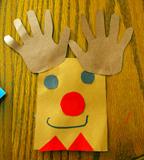 Child handprint craft of deer